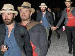 Bromancing the night away! Party pals Kellan Lutz and Danny Masterson hold hands at Coachella's Neon Carnival