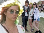 Kesha shows off wrapped ankle while rocking a floral print romper and multicoloured hair at Coachella