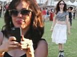 Rose McGowan swaps tight black tank dress for midriff baring crop top at Coachella festival
