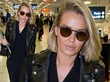 Touch down: The model and designer wore her trademark all-black ensemble