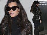 Booty-full escape! Kim Kardashian shows off her incredible figure in yoga tights and knee high boots for a flight out of town