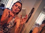 Kisses to all! Lindsay Lohan snaps sexy selfie in plunging one-piece bathing suit