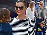 Miranda Kerr pushes three-year-old Flynn in a pram on mother and son day out in New York City