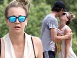 Kaley Cuoco and Ryan Sweeting are still in the honeymoon phase as they share a passionate kiss during sweaty workout