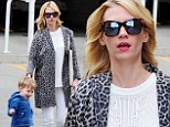 On the prowl for a good read! January Jones dons leopard print coat for day out at book fair with son