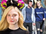 Well she is Princess Aurora! Elle Fanning poses at Disneyland's Sleeping Beauty Castle... then hits rides with 'new boyfriend'