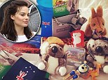 'Care package from home!' Robbie is thrilled after receiving a package filled with cute koala bears, Tim Tams and other Aussie-themed delights