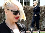 Amazingly the new mother finished off the look with newly highlighted, stylishly cut blonde hair - and even her trademark perfect red pout.