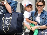 Super mum! Miranda Kerr showed off her impressive strength as she juggled her son Flynn and her $3k Chanel tote in New York City on Monday