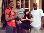 Jealous, Alec? Hilaria Baldwin shared a picture of herself being held up by NBA Jermaine O'Neal and Draymond Green, as Harrison Barnes stood in prayer pose