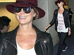 'You know when you know': Stacy Keibler explains sudden marriage to multimillionaire with clever T-shirt as she touches down in LA