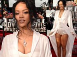 Night in white satin! Rihanna looks ready for bed in a VERY plunging robe and tiny playsuit at MTV Movie Awards