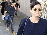 Lily Allen is a golden girl in Nike trainers while out and about in London