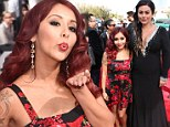 Snooki shows off her bump in rosy dress while pregnant pal JWoww takes the plunge in sparkly black gown at MTV Movie Awards