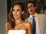 He's behind you: Jessica Alba is unaware Johnny Knoxville is behind her pulling a funny face while she poses for pictures at the MTV Movie Awards, on Sunday