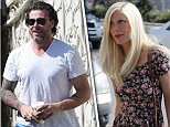 Tori Spelling and Dean McDermott put on a united front at meditation and life-coaching centre together with wedding rings firmly on