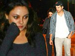 'Pregnant' Mila Kunis obscures her baby bump behind Ashton Kutcher as they step out for burgers