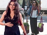 Still keeping mum? Mila Kunis is spotted attending parental exercise classes and having pregnancy 'cravings'