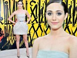 She shamelessly stylish: Emmy Rossum stuns on the red carpet in pastel tulip dress as she shows off her slender pins