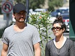 Happy as they are: Sources have dismissed claims that Kourtney Kardashian plans to marry her boyfriend Scott Disick in Mexico this summer