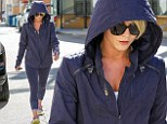 Fitness fan:  Julianne Hough is coy as she hides under hood as she leaves gym session