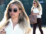 She's all grown up! Lauren Conrad shows off her business casual side in a pair of slimming maroon trousers and a billowing polka dot top