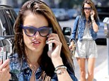 No time for a blow-dry? Model Alessandra Ambrosio rushes to a meeting with wet hair but shows off her legs in short jumpsuit