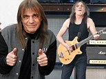 AC/DC guitarist Malcolm Young performs in Glasgow in June 2009 as part of their Black Ice Tour. It is understood the 61-year-old rocker is 'seriously ill' and may never perform live again