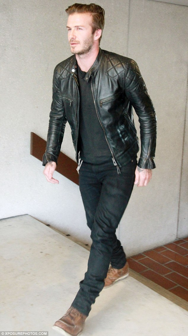 Straight off the plane: David didn't change after his flight, but looked devilishly handsome all the same