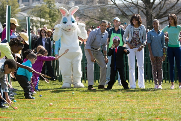"""President Obama, Mrs Obama, Sasha and Malia with """"Kid President"""" Robby Novak on the South Lawn for the 2013 White House Easter Egg Roll, April 1, 2013."""