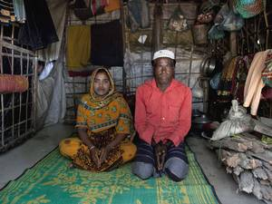 Hamid and his daughter Rajama sit inside their home in the Shamalapur Rohingya refugee settlement in Chittagong district. They fled to Bangladesh from the Dhuachopara village in the Rachidhong district of Myanmar