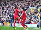Raheem Sterling and Luis Suarez celebrate during Liverpool's game with Norwich