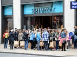 France: Students stand outside a Primark in Oxford Street
