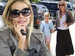 Motherhood comes natural! Denise Richards goes make-up free to take eight-year-old daughter Lola bicycle shopping