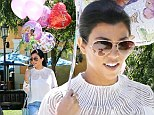 'I have the best friends!' Kourtney Kardashian gets carried away by a huge balloon bouquet as her 35th birthday celebrations continue