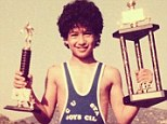Winning: Young Mario Lopez showing off wrestling trophies in a 'throwback Thursday' picture