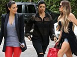 Kim Kardashian's red leather trousers and Khloe's Daisy Dukes leave Kourtney in the shade as they film for reality show