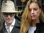 Long night? Amber Heard appeared tired as she and her fiance Johnny Depp left their hotel in New York City Friday