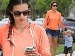 She sure loves to recycle! Alessandra Ambrosio wears same orange sweatshirt for yoga session and while out with son Noah