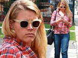 Make-up free Busy Philipps displays her toned pins in cuffed jeans