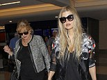 Mother and daughter: Fergie and her mother leave LAX on Thursday after flying in from New York where the singer celebrated the Brown Shoe Company 100 years of listing on the New York Stock Exchange