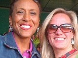 Best friends: Robin Roberts has described her girlfriend Amber Laign (right) as the 'wind beneath my wings' - and has revealed that throughout their decade-long relationship, the couple have lived separately