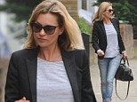 Kate Moss steps out in ripped denim