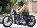 Going in One Direction: Harry opted for a pair of skinny jeans for the ride, while he wore a checked shirt under his heavy-duty coat on Wednesday