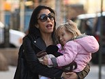 Not letting go: Former reality star, Bethenny Frankel, clung on to her daughter Bryn as they went for a stroll in New York on Thursday