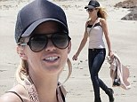 That's hardly beach attire! AnnaLynne McCord is overdressed in jeans and boots for stroll along the shore in Malibu
