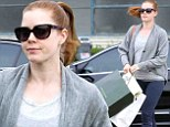 She knows how to spend it! Amy Adams empties her wallet in upscale Beverly Hills boutiques... after bargain hunting at Target