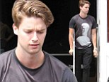 Still poorly! Patrick Schwarzenegger spent some time hanging out in Brentwood, but was taking things slow, however, limited by a crutch