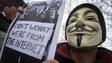 A protester wearing an Anonymous Guy Fawkes mask takes part in a demonstration in Zagreb, Croatia, on 11 February 2012