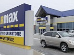 In this file photo taken Monday, Dec. 20, 2010, a car drives past the CarMax sign at the dealership in Oak Lawn, Ill. CarMax on Monday